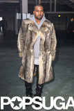Kanye West rocked a fur coat at Paris Fashion Week on Friday.