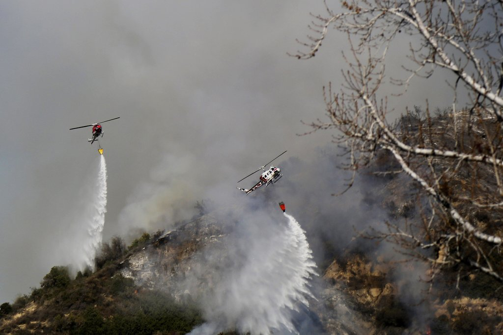 Helicopters worked to control the flames.