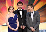 Amy presented an award with Bradley Cooper and Jeremy Renner.