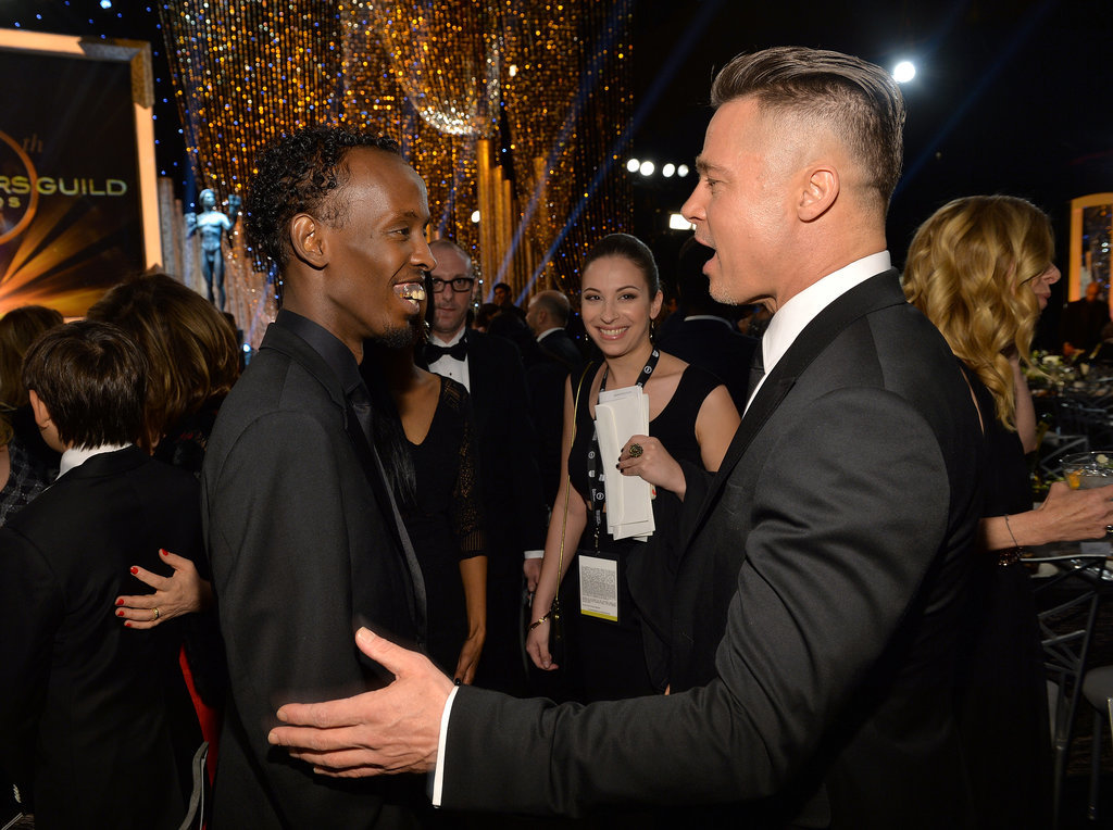 Brad Pitt chatted with Barkhad Abdi.