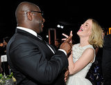 Steve McQueen and Sarah Paulson laughed.