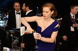 Amy Adams poured herself a drink.