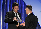 Ben Affleck handed Brad Pitt his award.