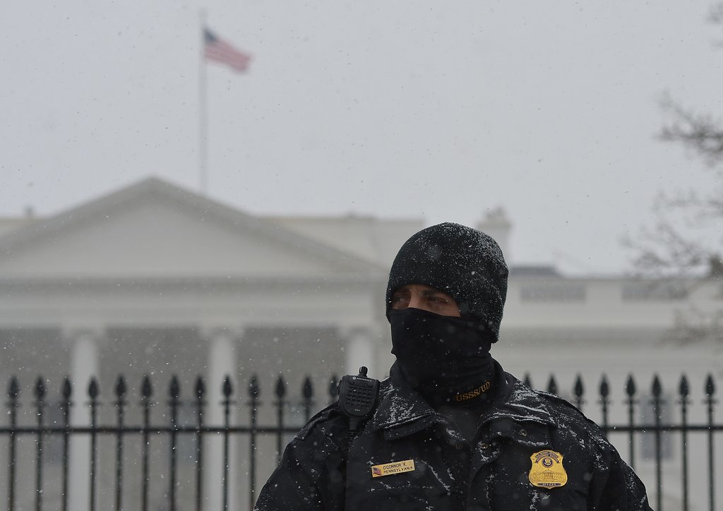 A White House worker covered up for the chilly temperatures in Washington DC.