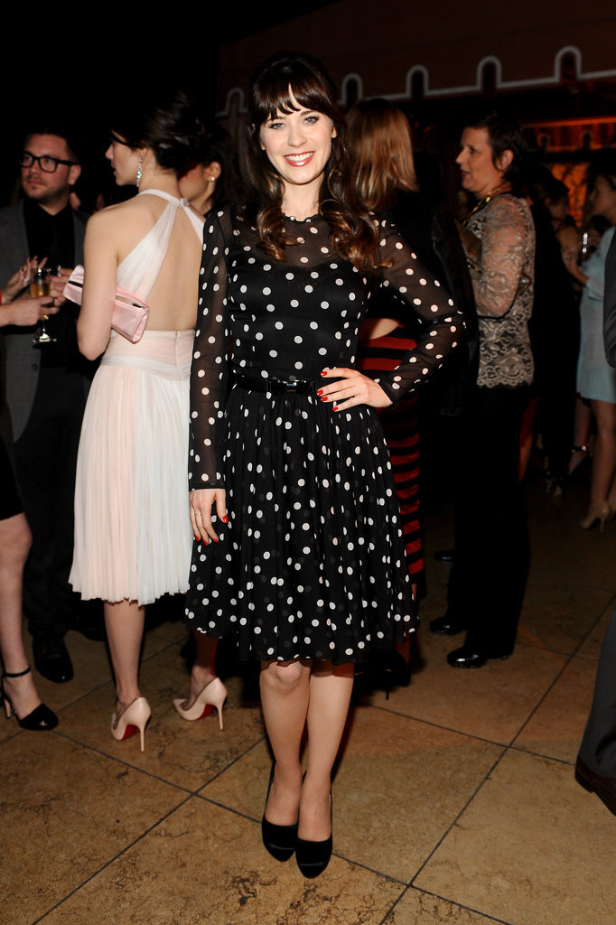 "Zooey Deschanel wore a polka-dot Dolce & Gabbana look to the event, where she told us she's not tired of talking about Prince. He'll be appearing on New Girl as her ""love coach"" on an upcoming episode."
