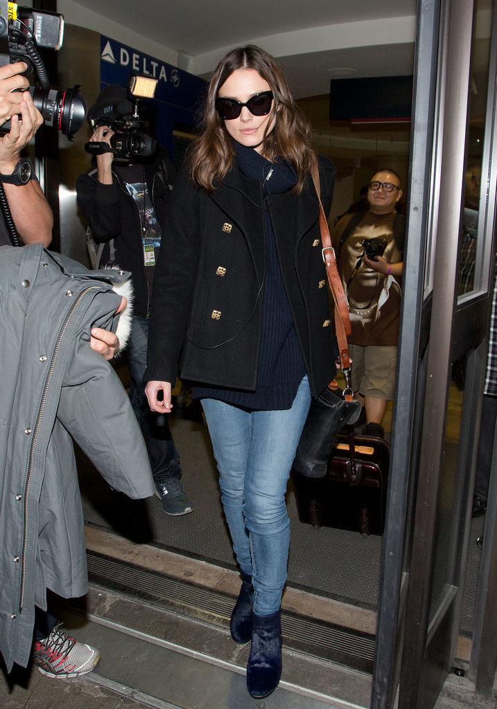 Keira Knightley wasn't afraid to mix black and blue in her ribbed sweater and peacoat. She finished off the look with jeans and a pair of ponyhair boots for added texture.