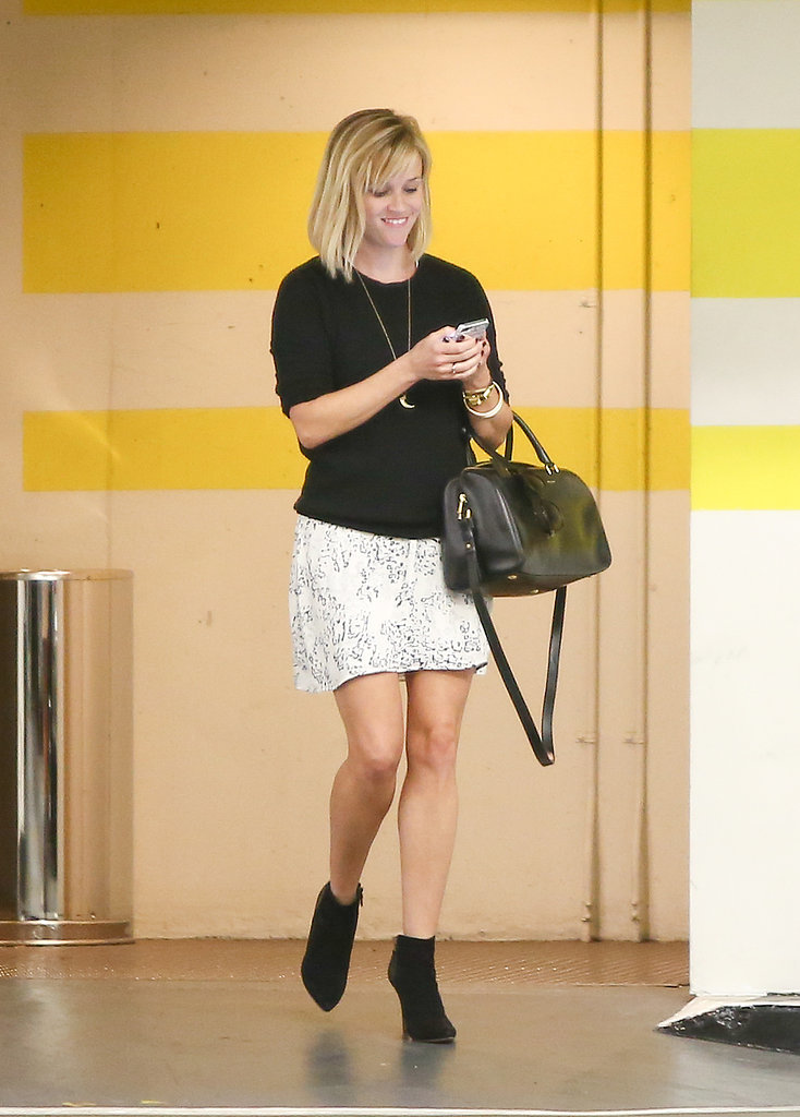 Reese Witherspoon texted while walking around LA on Monday.