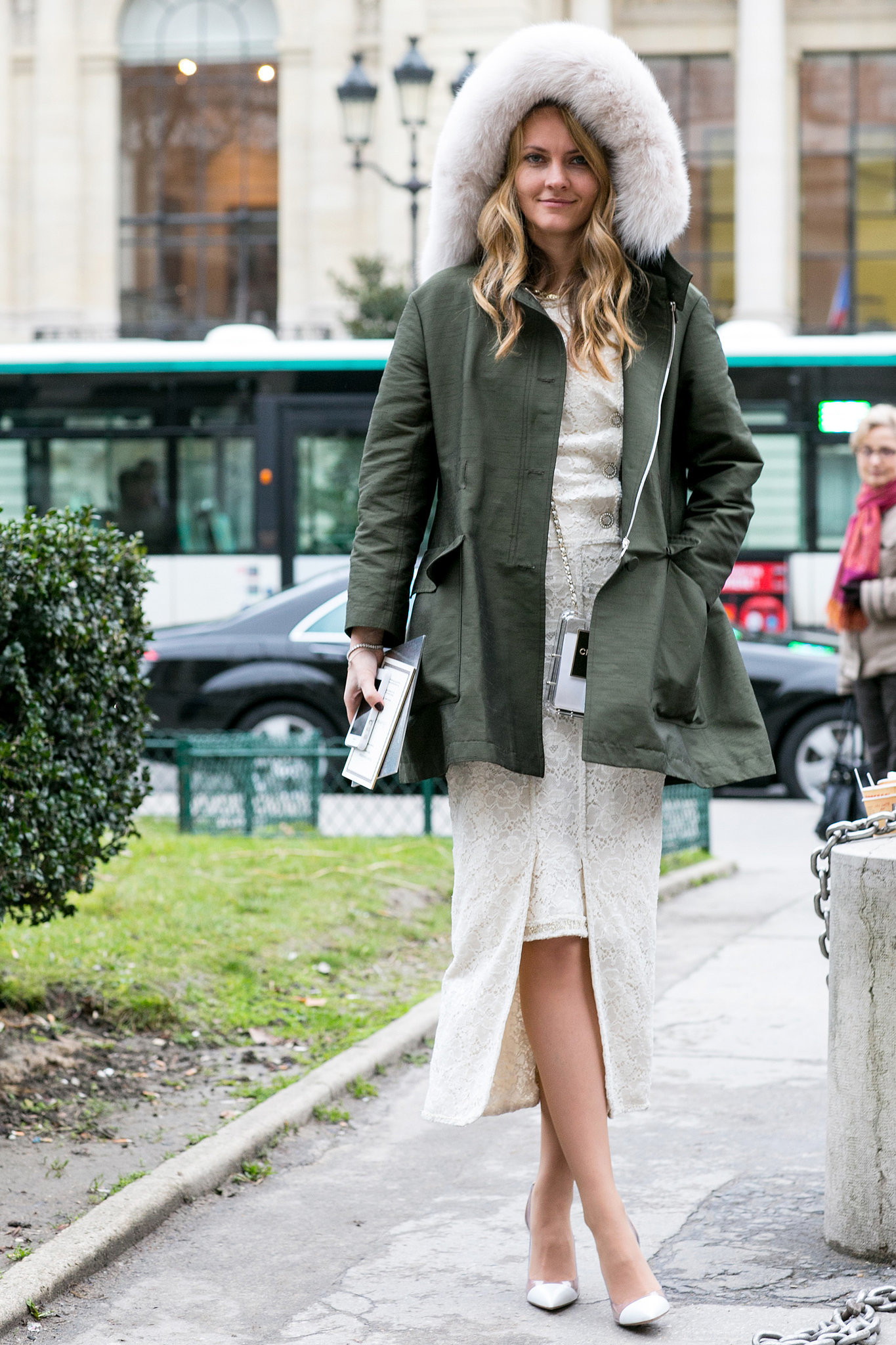 There's nothing we love more than a tough-meets-feminine mix-up like an anorak to warm up a pretty white dress.