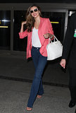 Miranda Kerr arrived at LAX looking impossibly fresh in a pretty pink blazer, dark flared denim, and a white Prada handbag in June 2013.  Where to Wear: A mani-pedi date with your gal pals.