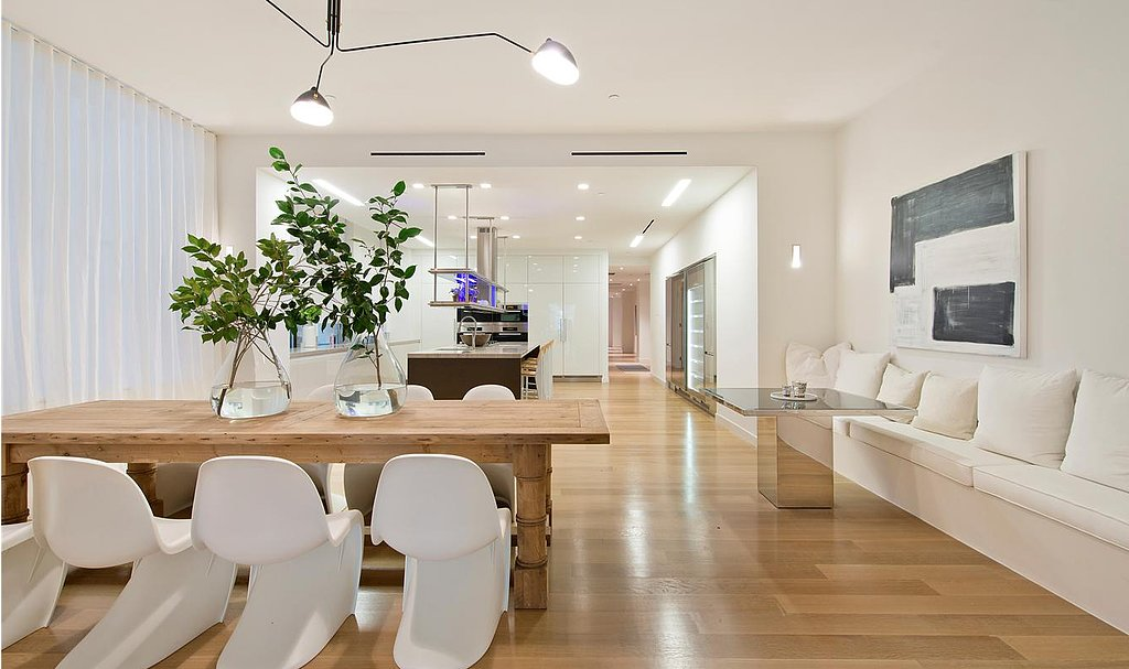 Wood and white tones lend an earthy yet modern aesthetic.  Source: Douglas Elliman Real Estate