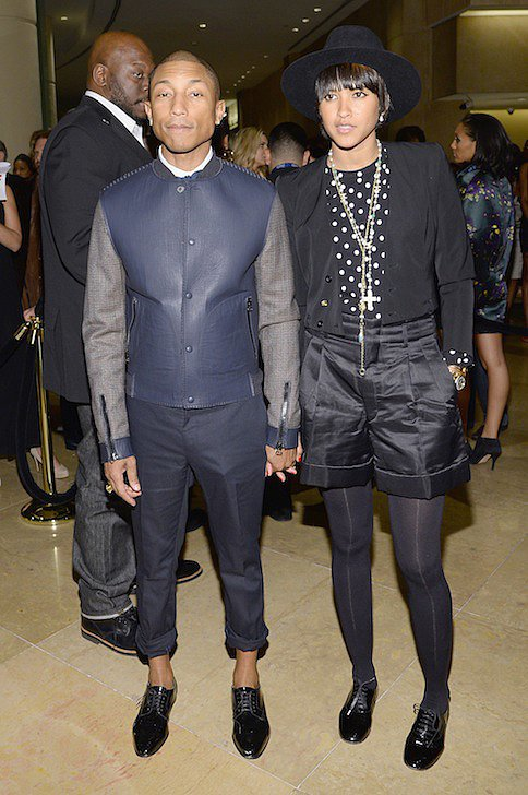 BEVERLY HILLS, CA - JANUARY 25: Musician Pharrell Williams and Helen Lasichanh attend the 56th annual GRAMMY Awards Pre-GRAMMY Gala and Salute to Industry Icons honoring Lucian Grainge at The Beverly Hilton on January 25, 2014 in Beverly Hills, Calif