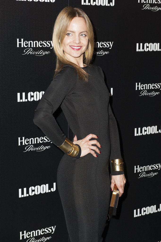 Mena Suvari posed for pictures when she arrived at LL Cool J's party.
