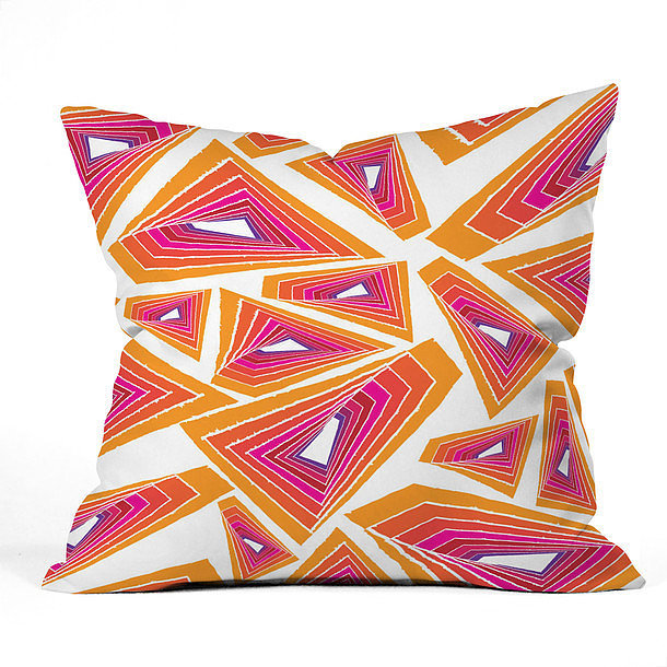 Use a graphic toss pillow ($19, originally $45) to give life to basic bedding.