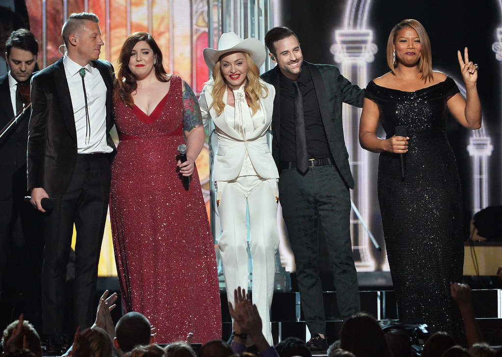 Queen Latifah held up a peace sign as the performers linked up on stage.