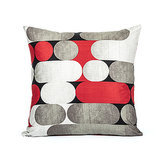 Add red and charcoal hues with a contemporary accent pillow ($24).