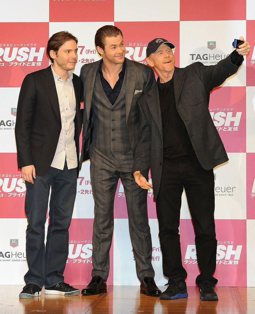 Ron Howard took a selfie with Chris Hemsworth and Daniel Brühl at a Rush press conference on Tuesday.