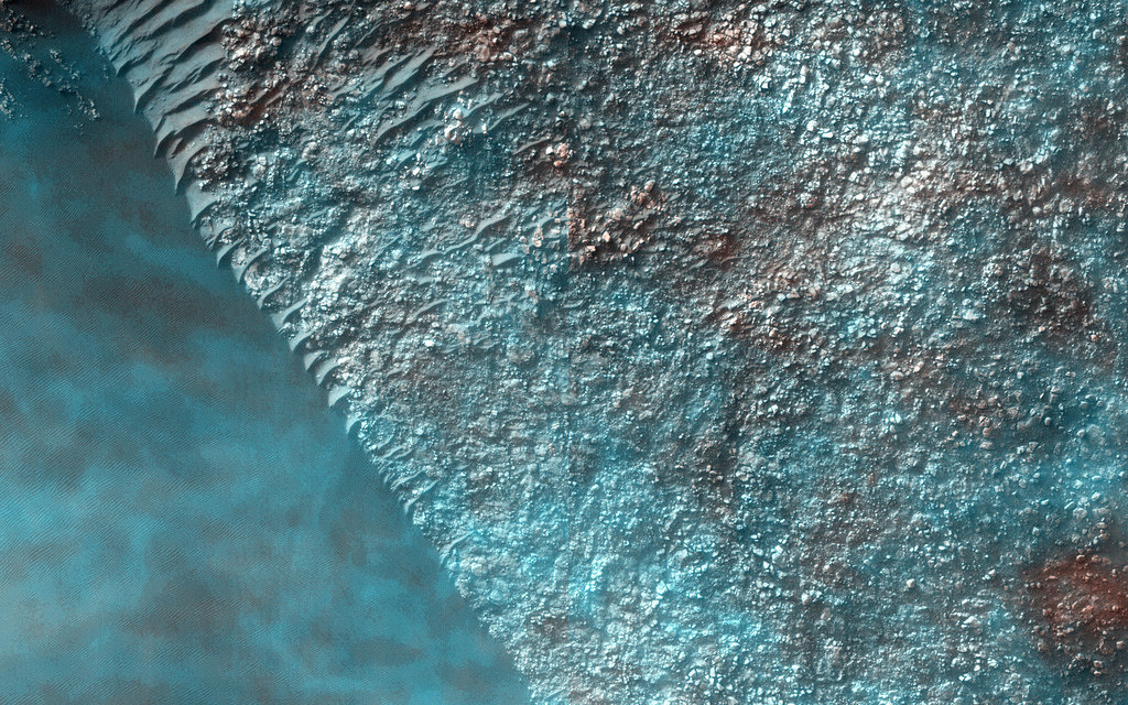 """What we see are thin condensate clouds moving relative to surface features. They appear to move 200 meters distance over the 0.1855 second between the infrared and blue-green imaging, or 1.08 kilometers per second!""  Source: NASA/JPL/University of Arizona"