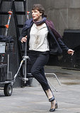 Milla Jovovich was on the move as an embattled State Department employee on the set of Survivor in London on Monday.