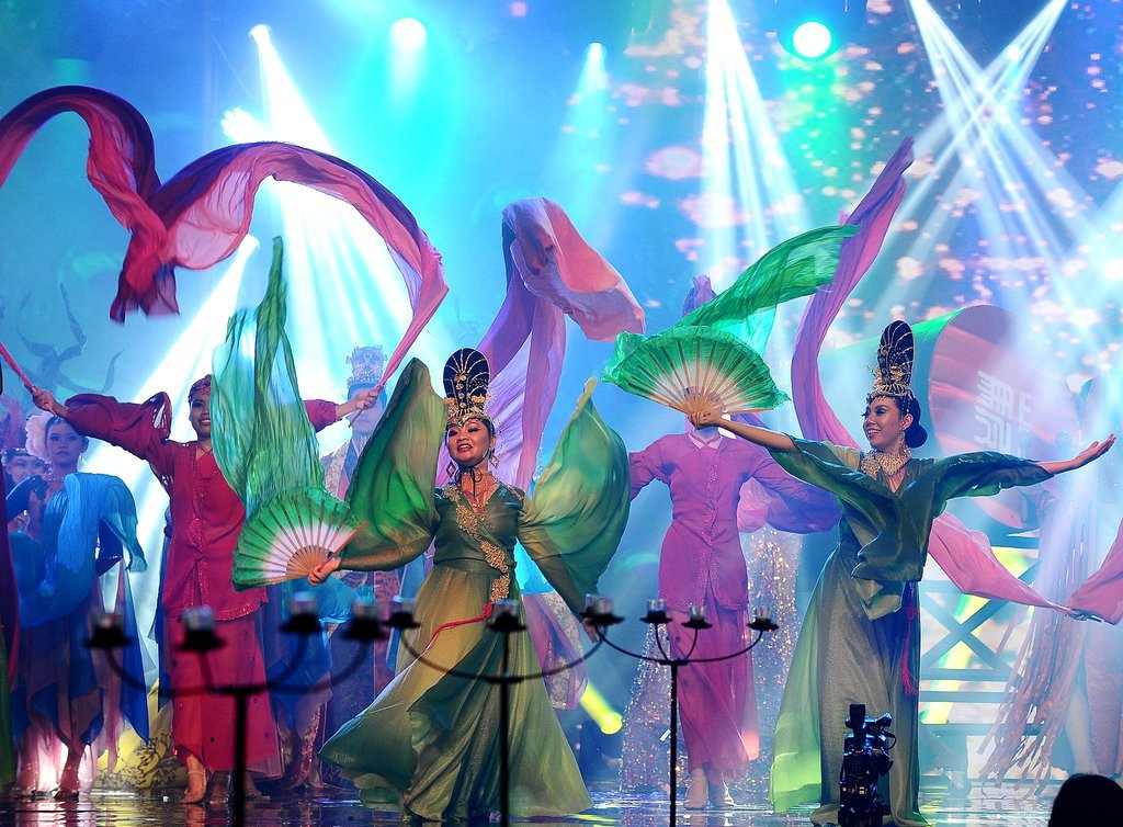 Actors hit the stage for a traditional performance in Surabaya, Indonesia.
