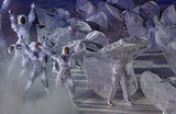 People in tinsel-style costumes hit the ice.