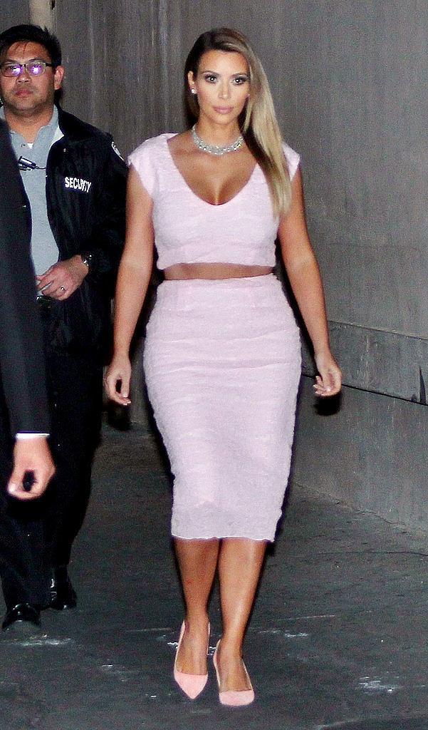 Kim Cuts Her Dior in Half!