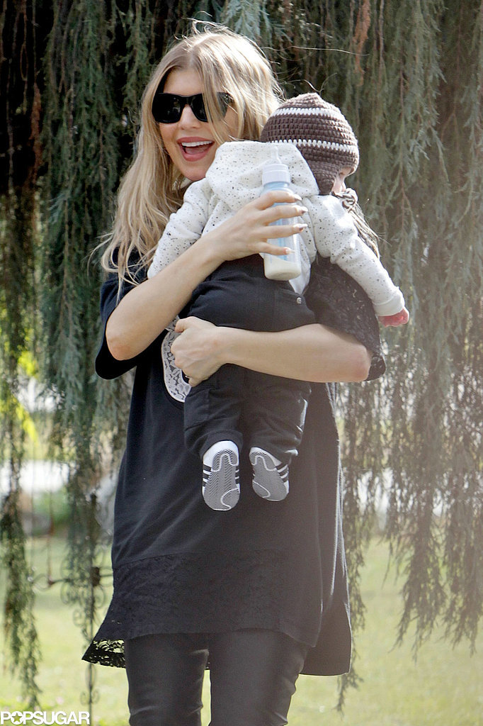 Fergie was all smiles while holding her son, Axl, in LA on Super Bowl Sunday.