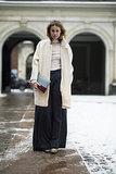 Wide leg pants further the vintage flair of a fuzzy coat. Source: Le 21ème | Adam Katz Sinding