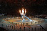 And then everyone held hands around the tall Olympic flame.