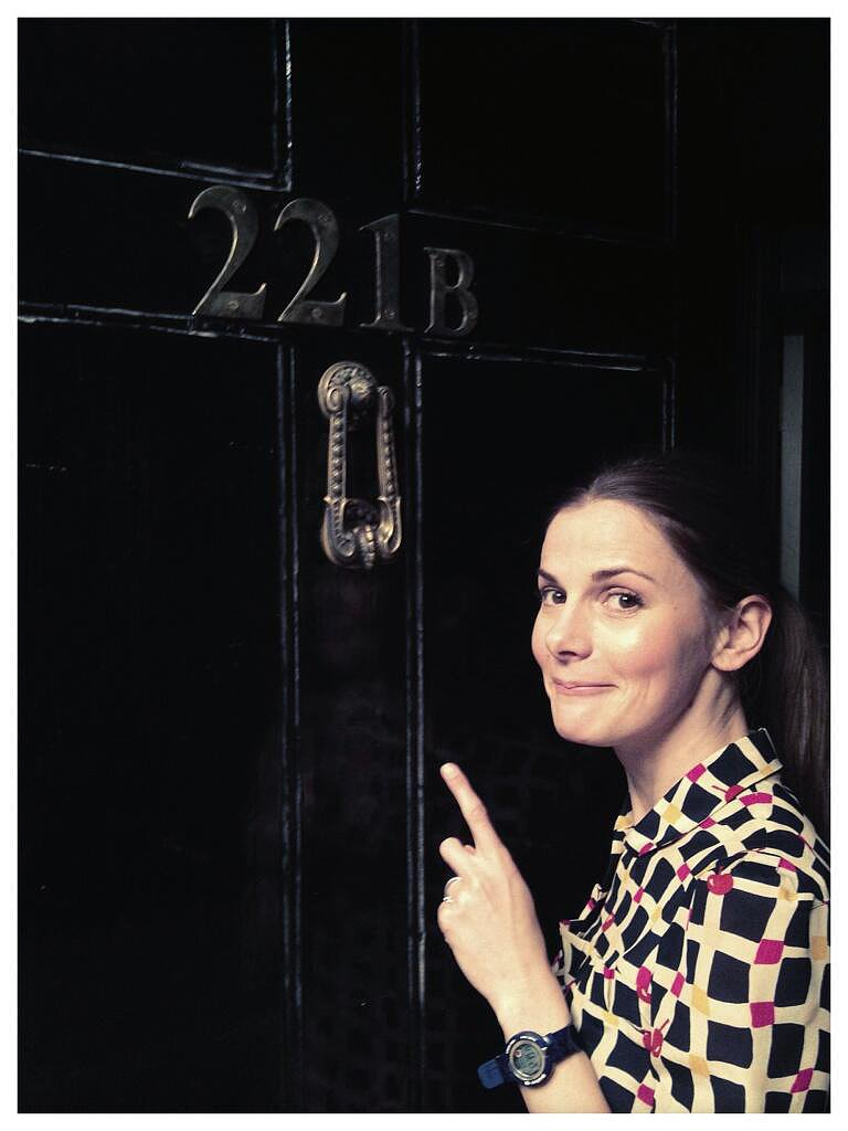 """And here's me at the front door. Helpfully, I'm pointing out the number."" — Louise Brealey who plays Molly Hooper. Source: Twitter user louisebrealey"
