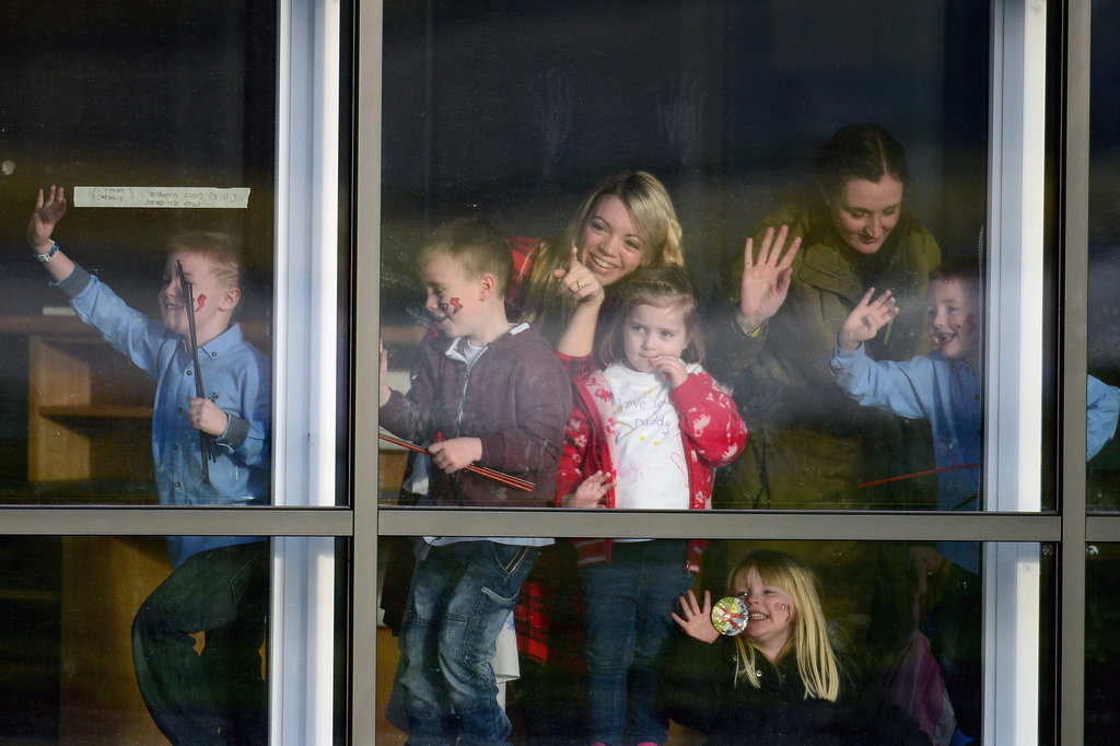 Friends and family stood near the window, waiting for the squadron's return.