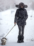 On Monday, Olivia Palermo braved the snow to walk her dog.