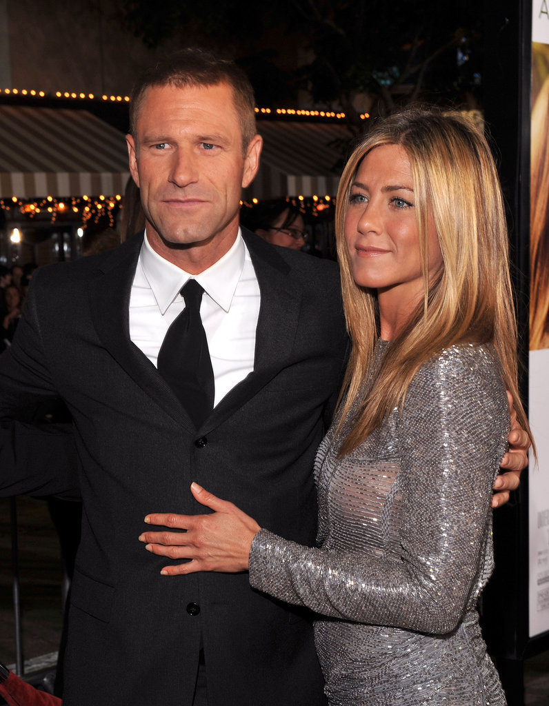 She stuck close to Aaron Eckhart at the Love Happens premiere in LA in September 2009.