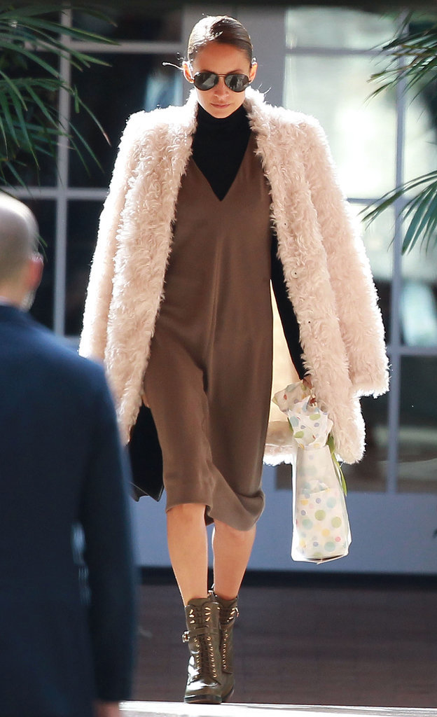 Nicole opted for a black and brown ensemble beneath her coat.