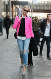 Karolina Kurkova added a perfect pop of pink to her distressed denim.