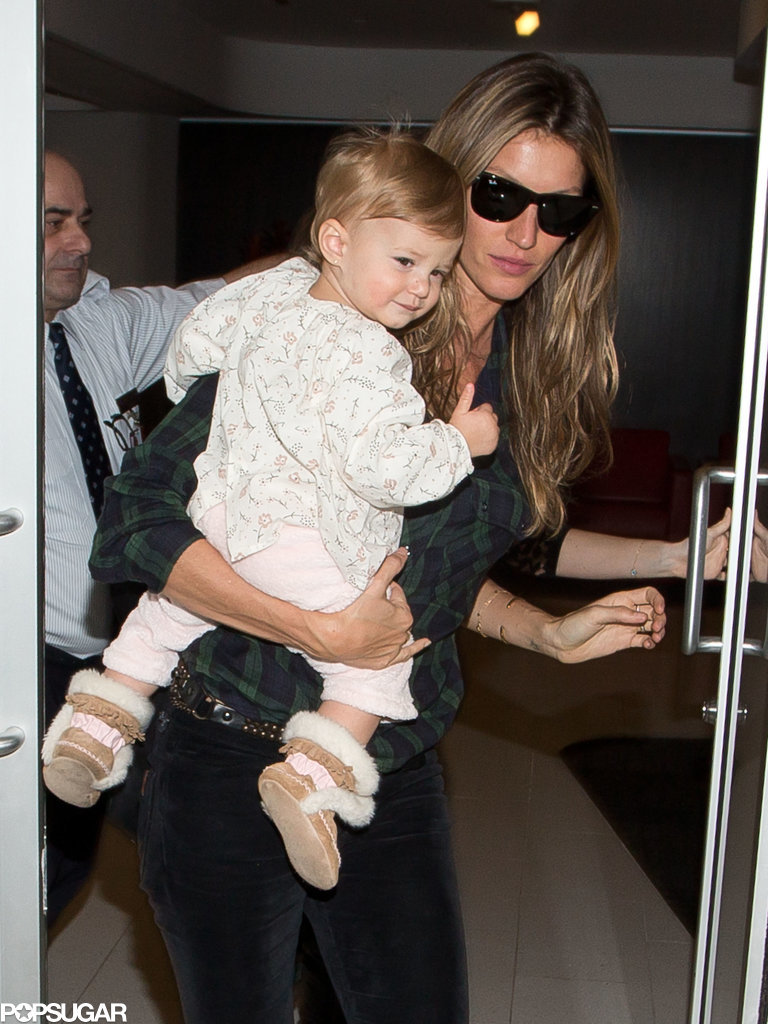 Gisele held smiley Vivian before they caught a flight at LAX on Sunday.