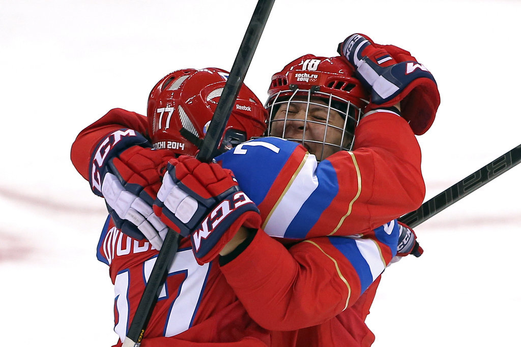 Russian ice hockey players Olga Sosina and Yekaterina Smolentseva hugged after scoring a goal in their team's game against Germany, which they eventually won.