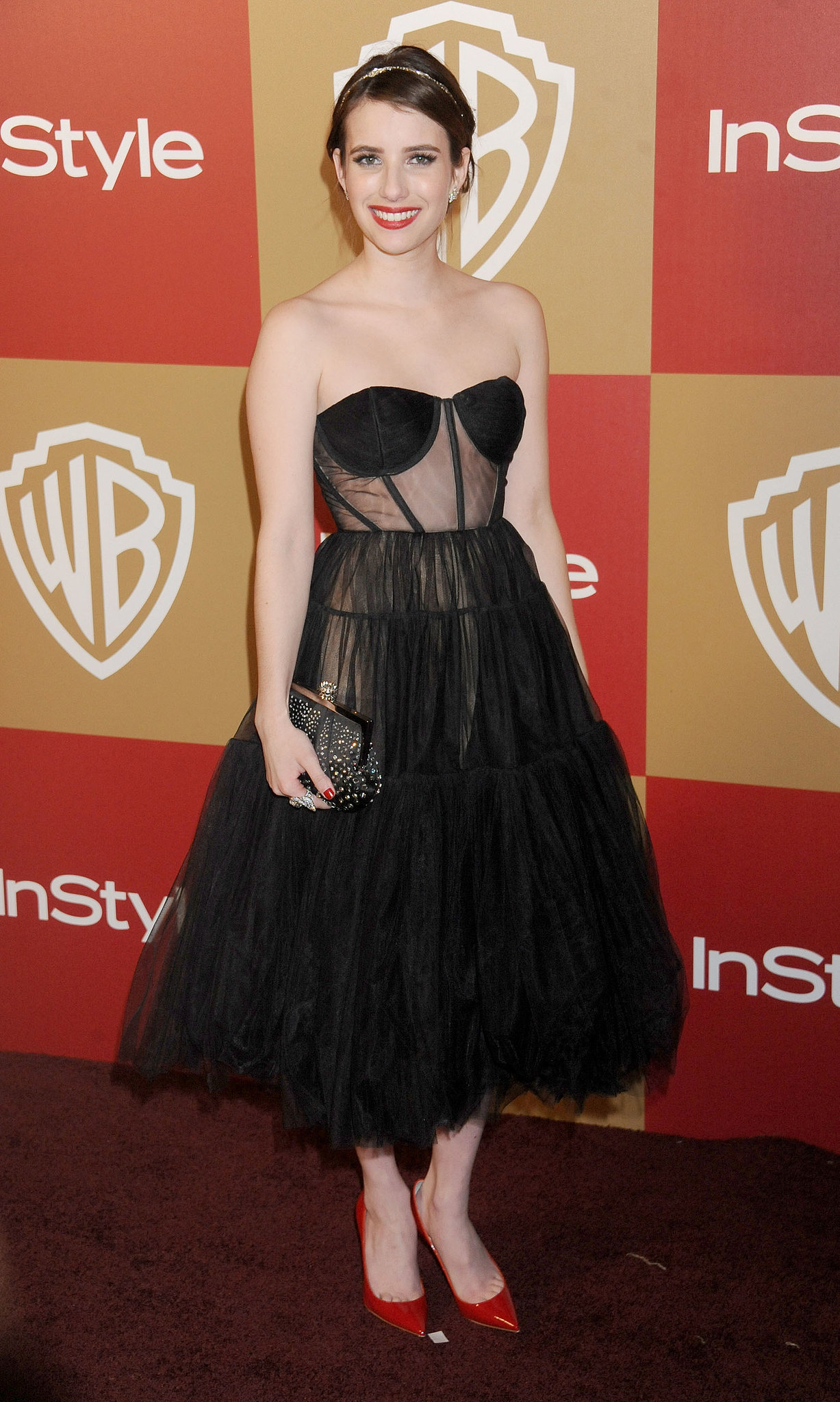 Emma wore a sexy, boudoir-inspired Maria Lucia Hohan dress to the InStyle Golden Globes afterparty in January 2013.