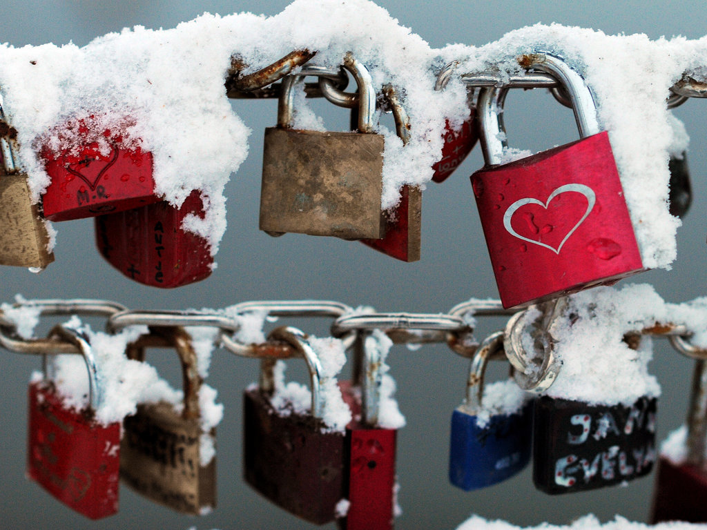 Love locks in Lübeck, Germany, are covered in snow.