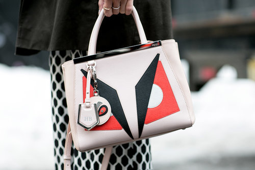 We adore this fierce Fendi clutch.