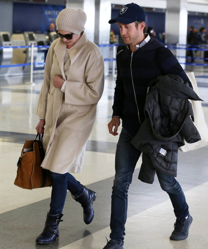 Anne Hathaway and her husband must have been jetting to somewhere chilly — she was super bundled up in an oatmeal topper, beanie, and fur-lined moto boots.