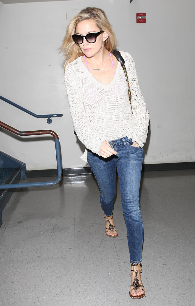 An eternally casual Kate Hudson picked a loose white sweater, skinny jeans, and embellished flat sandals.