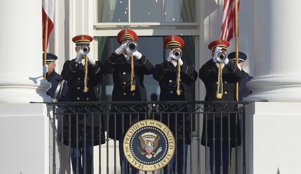 Trumpets sounded for the presidents' big entrance.