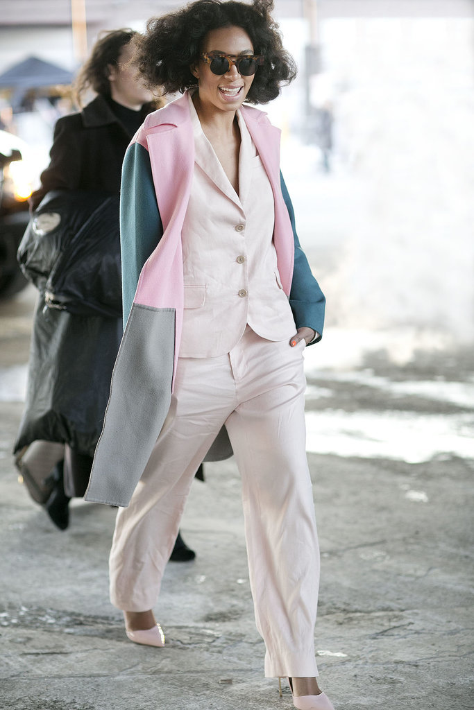 Solange added interest to a pale suit with a pop of pastel pink on her coat.  Source: Tim Regas