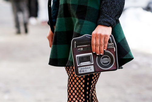 In any form, the camera is a must-have accessory at Fashion Week.