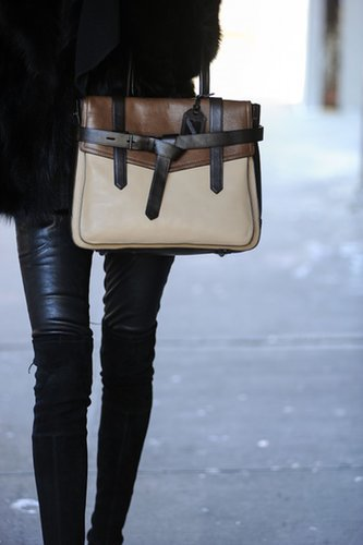 Reed Krakoff's beige and brown bag looked even better next to this all black look.  Source: Gorunway