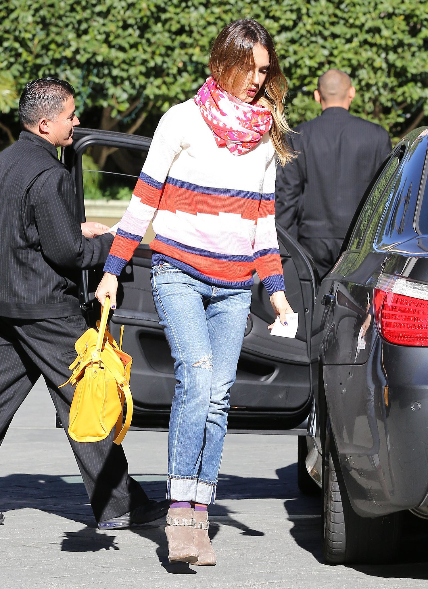The actress stepped out in LA, working a colorful striped sweater, ripped Level 99 denim, and suede buckled ankle boots. As if her off-duty style wasn't cool enough, she accessorized with a pink-and-orange Theodora & Callum scarf, a yellow Longchamp tote, and purple ankle socks for extra flair.