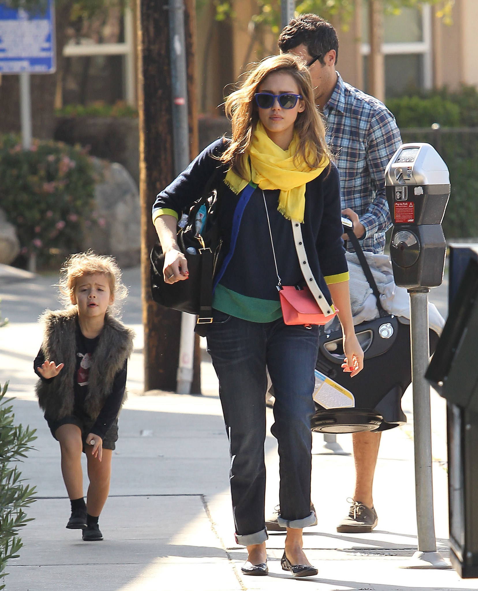 For Jessica's family lunch in LA's Brentwood, it was all about bright pops of color. The actress went casual in cuffed boyfriend jeans, a colorblock sweater, and bright yellow scarf.