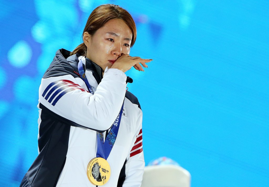 South Korea's Lee Sang-hwa wiped away tears after winning the gold in the women's speed skating 500-meter event.