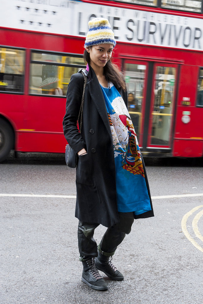 A painterly dress gets a grungy update with a slouchy knit, long coat, and distressed boots.