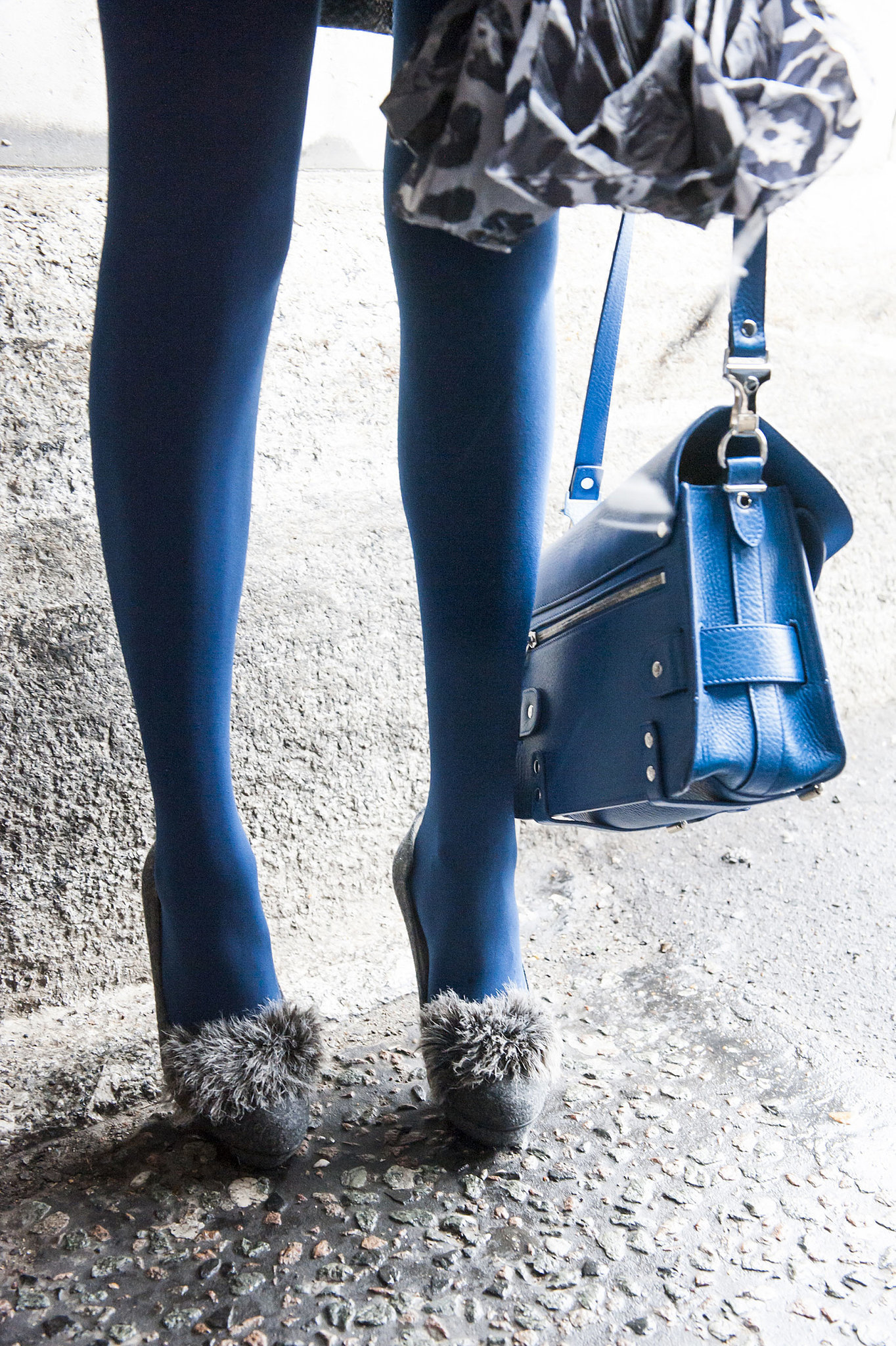 An unlikely duo — fuzzy heels and a bright Proenza Schouler bag.